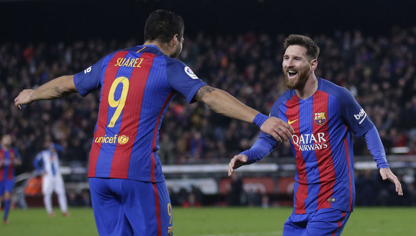 Barca cut deficit to Real thanks to magical Messi
