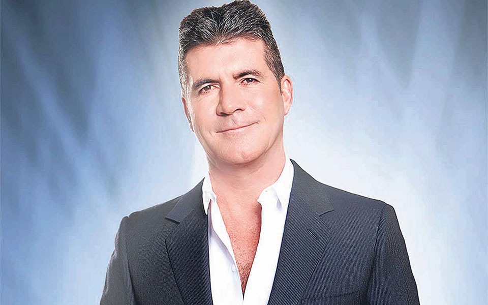 Cowell feels like a 'proud dad' towards One Direction