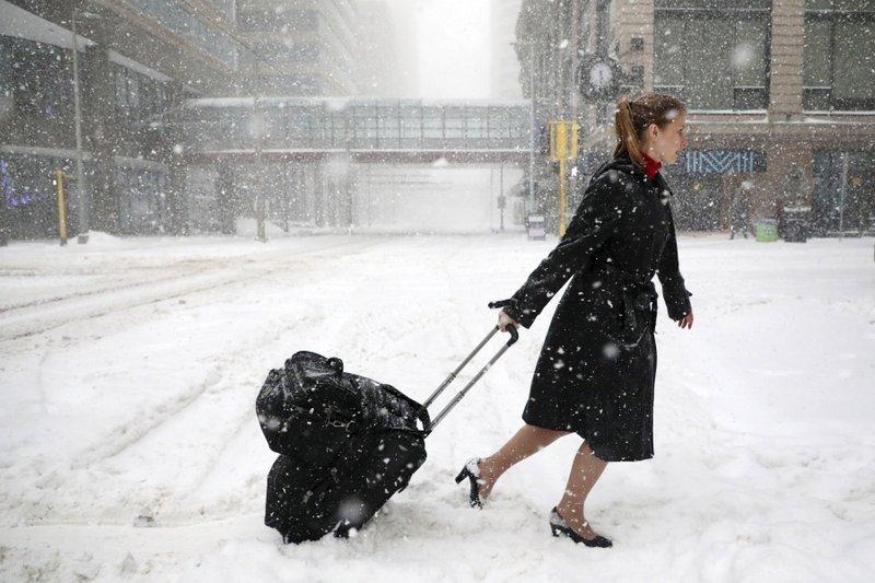 Flights canceled, roads treacherous amid spring snowstorms