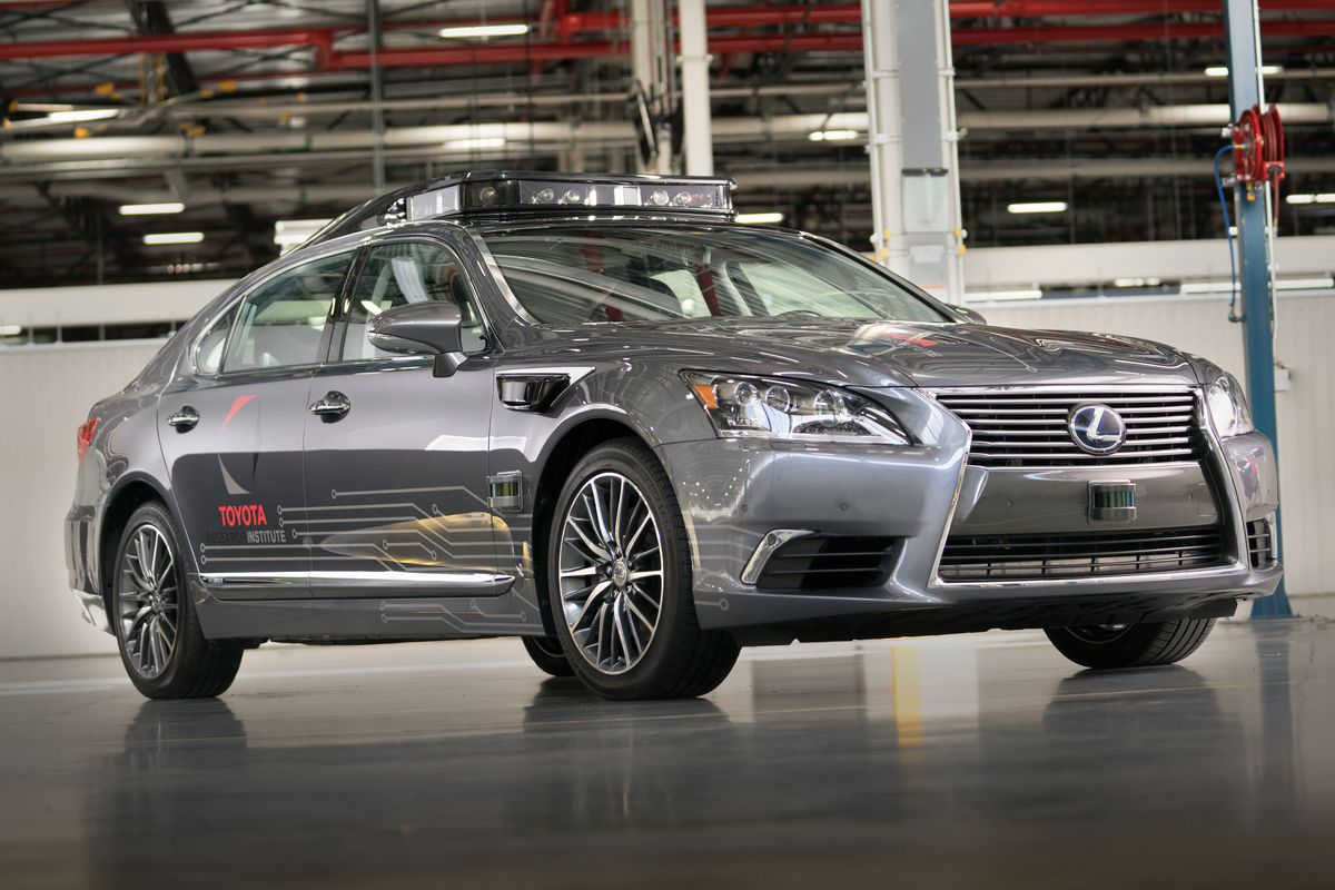 Toyota pours $500 mn into driverless car tie-up with Uber