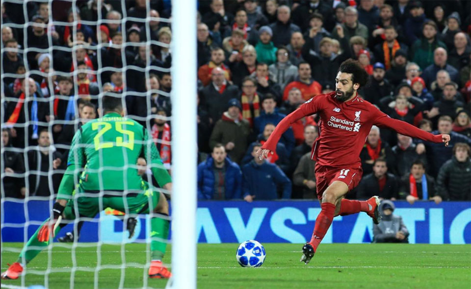Salah fires Liverpool into Champions League last 16