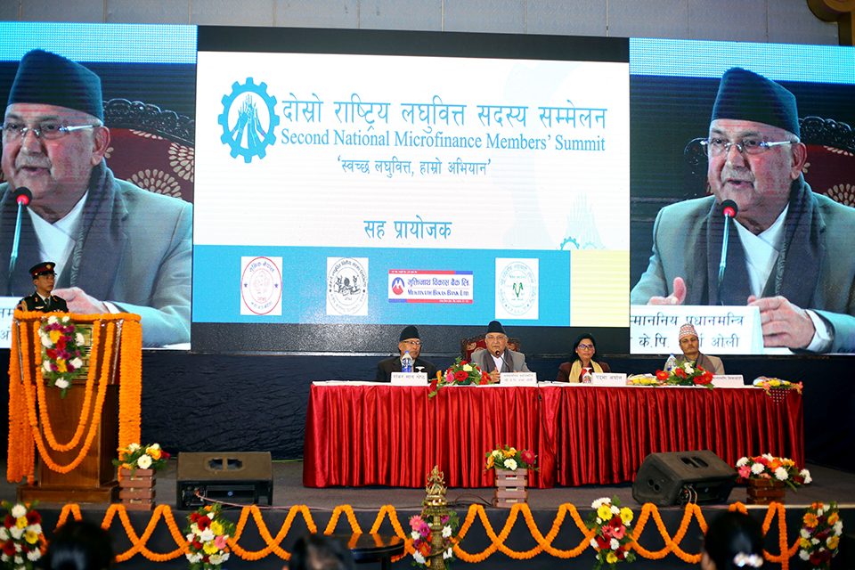 PM Oli urges microfinance institutions to invest in remote areas