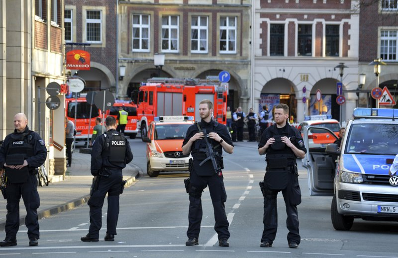 Germany seeks motive after van crashes into crowd, killing 2