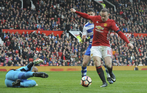Rooney equals record as United beats Reading 4-0 in FA Cup