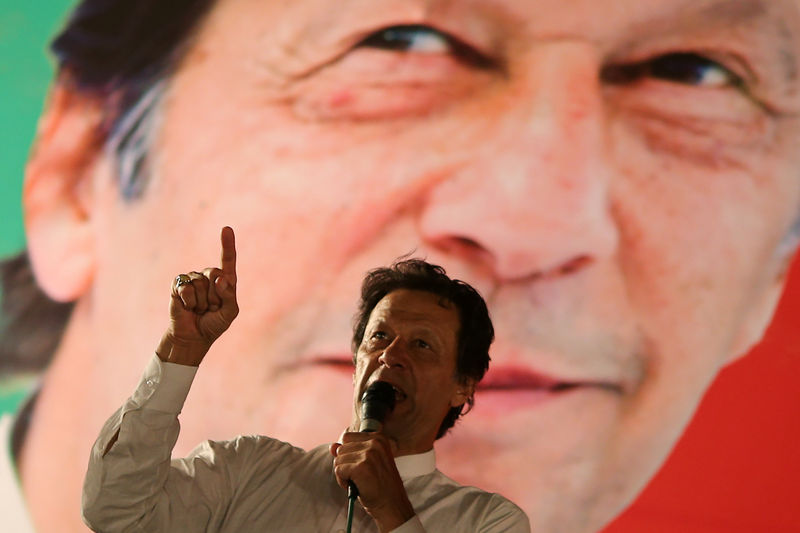 Pakistan's Imran Khan seeks election win over jailed ex-PM's party