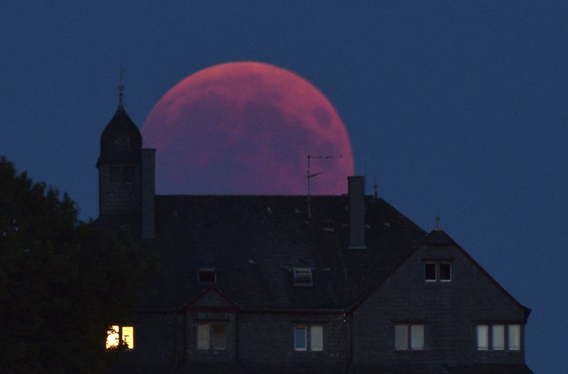 World gazes at the total lunar eclipse, longest of this century