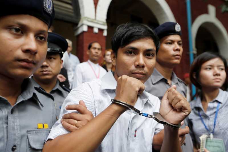 Myanmar court charges Reuters reporters under Official Secrets Act