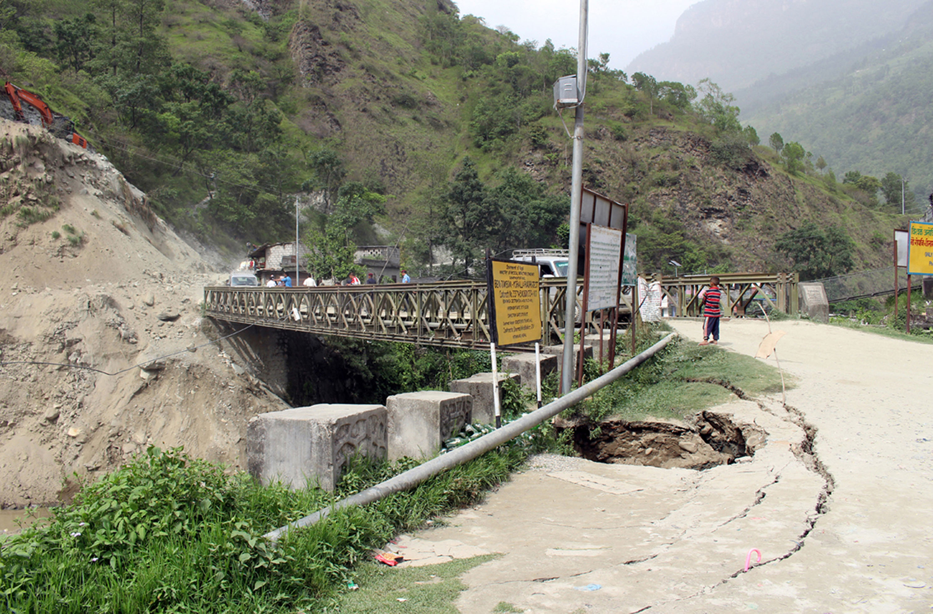 Bailey bridge facing collapse as road sinks