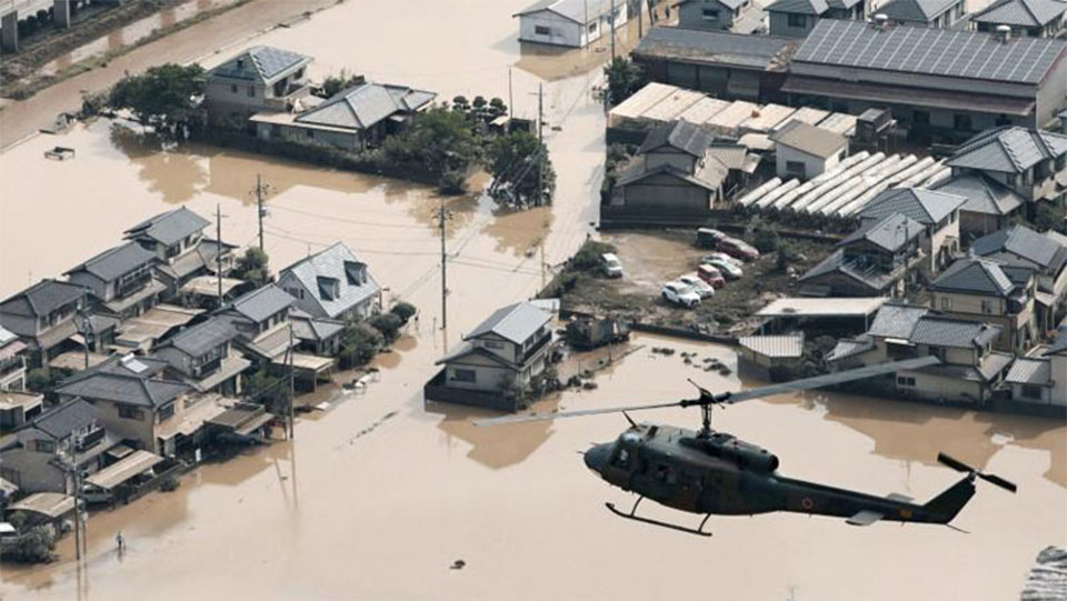 Japan flood toll nears 200, sun scorches thousands battling thirst
