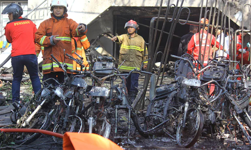 Indonesia church attacks: at least nine dead after bombs target Sunday masses