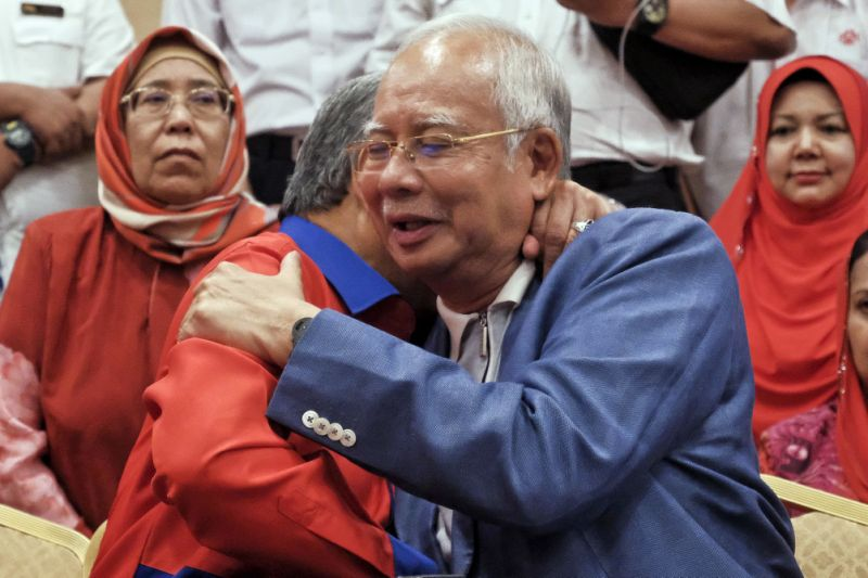 Malaysia bars scandal-ridden ex-leader from leaving country