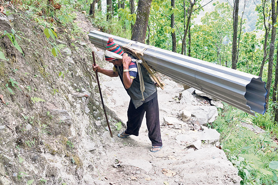Quake victims toil 7hrs uphill with construction materials