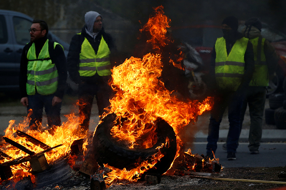 French police fire tear gas at fuel price protesters
