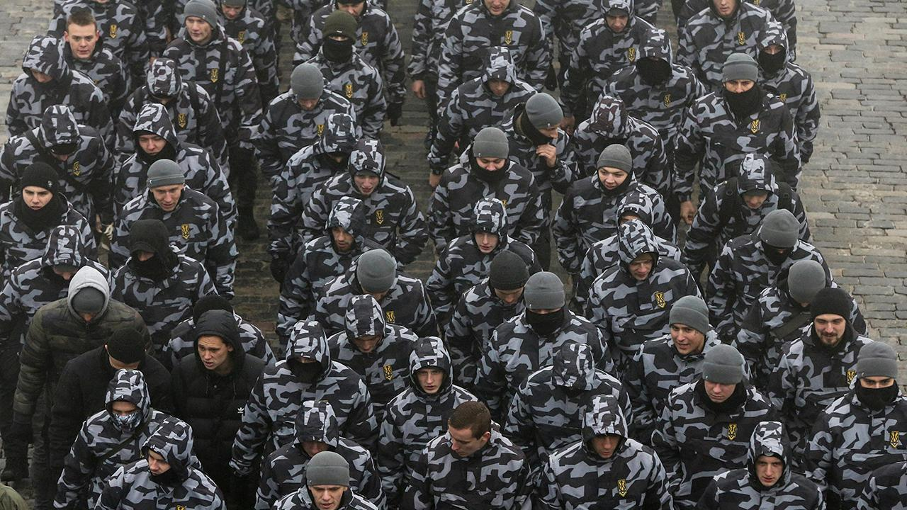 Ukraine imposes martial law amid 'extremely serious' threat of Russian invasion