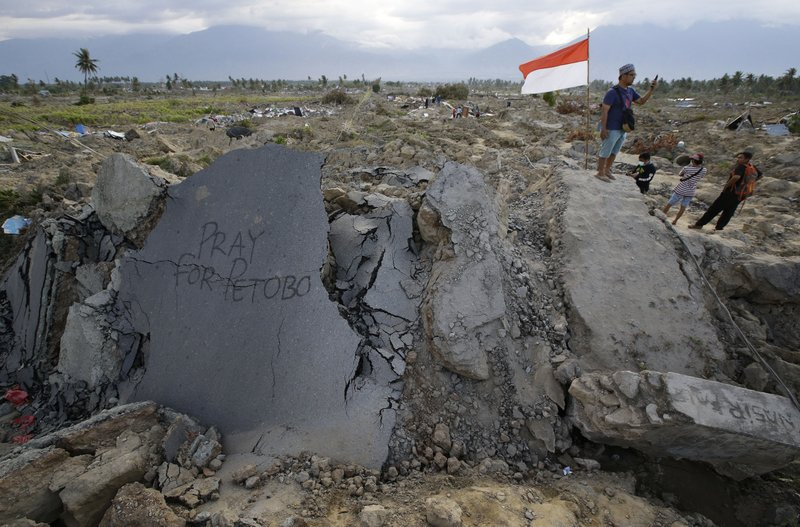 Indonesia disaster death toll climbs to 1,763