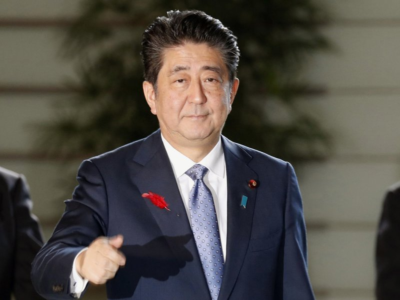 Japan's PM reshuffles Cabinet; foreign, trade ministers stay