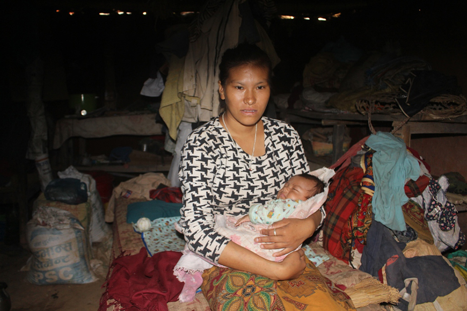 Unmarried mother facing social stigma