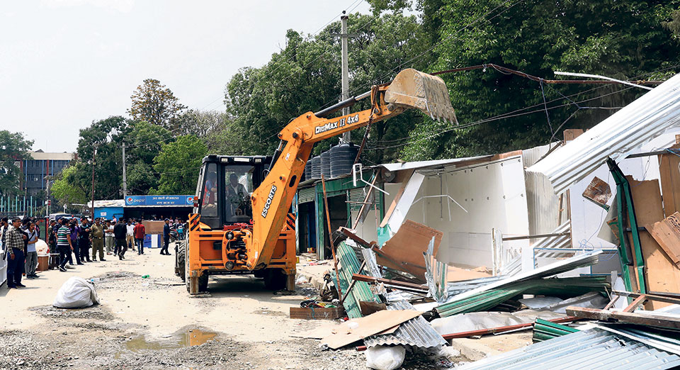 KMC bulldozes 52 illegally-built structures at Khulla Manch