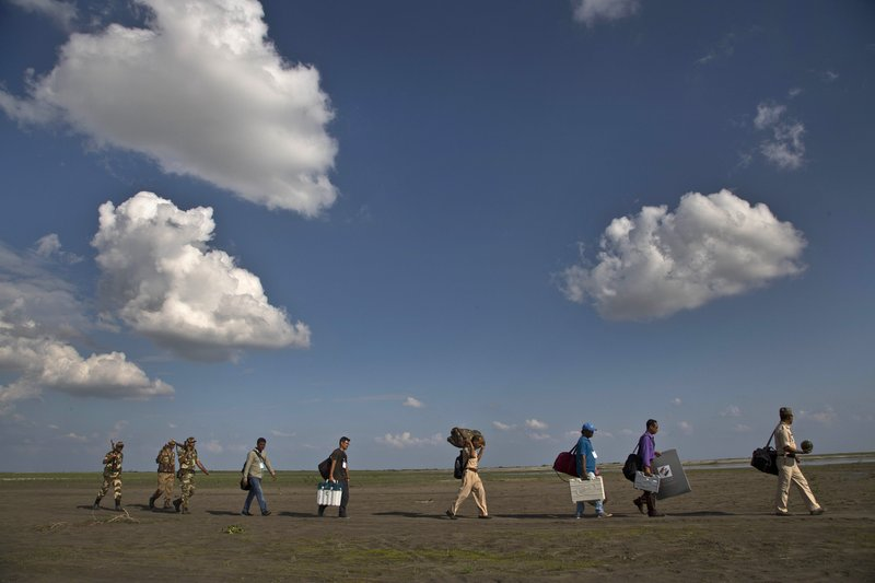 Poll workers journey to reach India's most remote voters