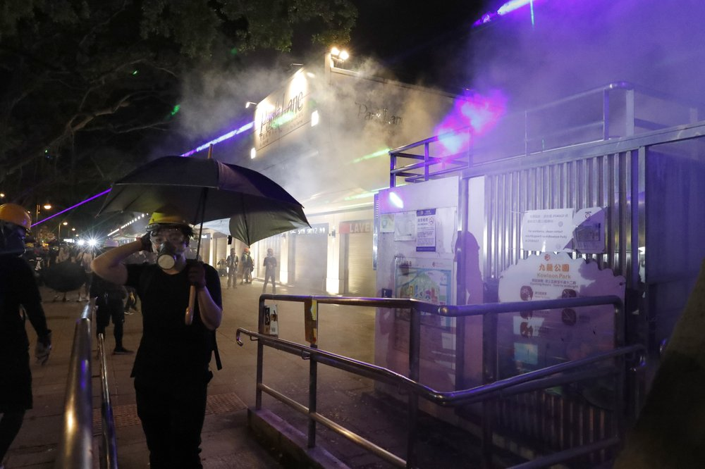HK police fire tear gas at protesters as marchers defy ban
