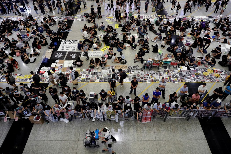 China says Hong Kong protests 'near terrorism' as airport reopens