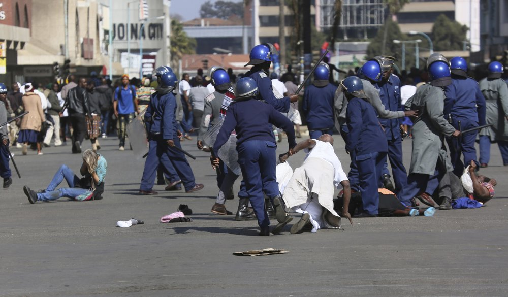 Zimbabwe police, protesters clash in Zimbabwe's capital