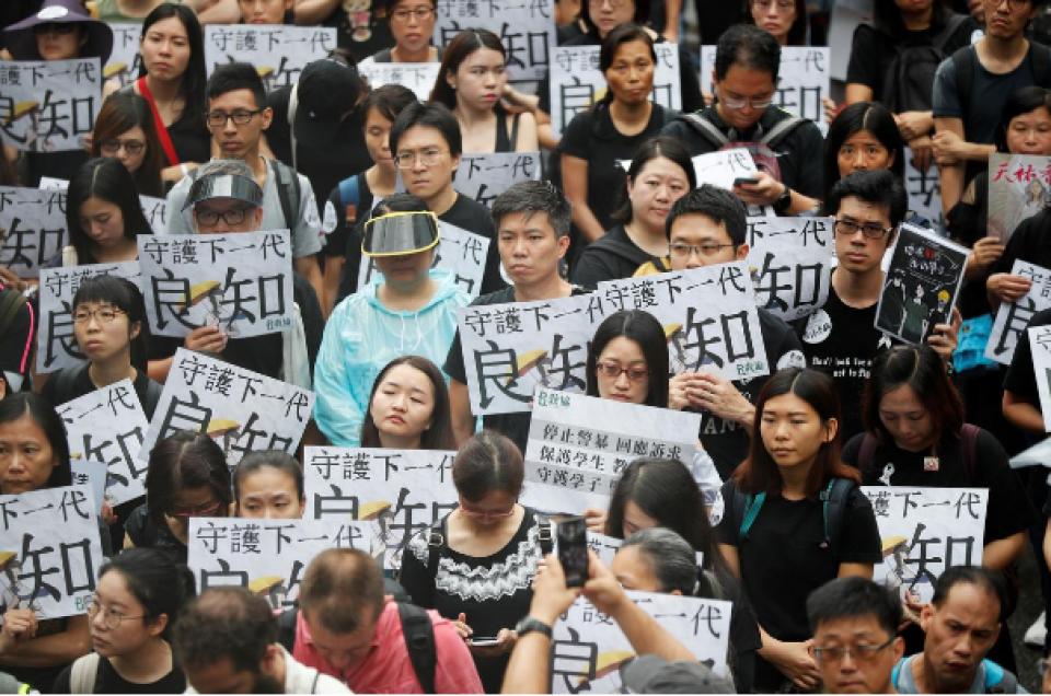 Hong Kong tense as weekend of protests begins with teachers' rally in rain