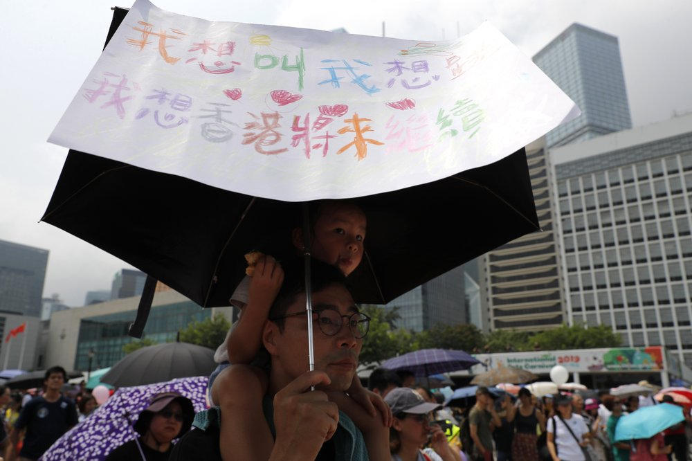 Hong Kong protests move forward despite police objections