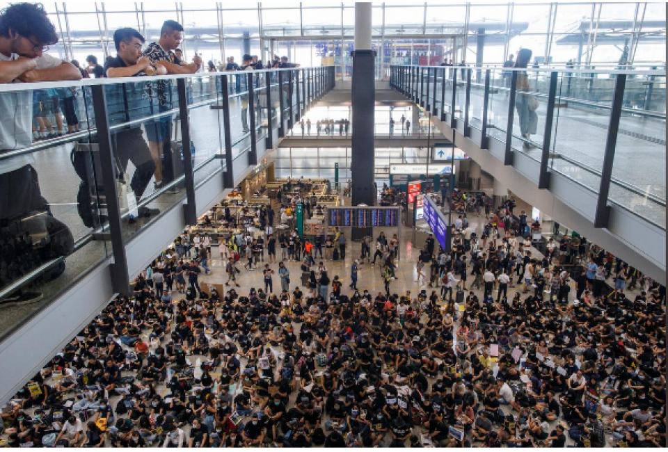 Protesters throng Hong Kong airport as property lobby calls for calm