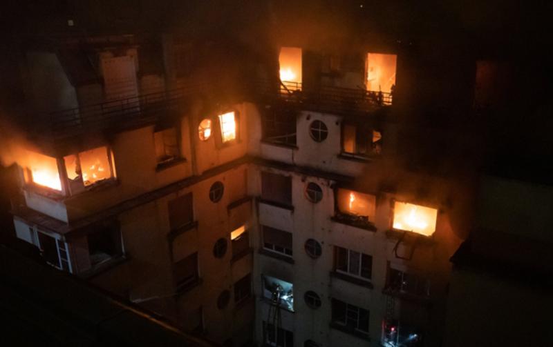 Blaze kills nine in Paris apartment block, woman arrested