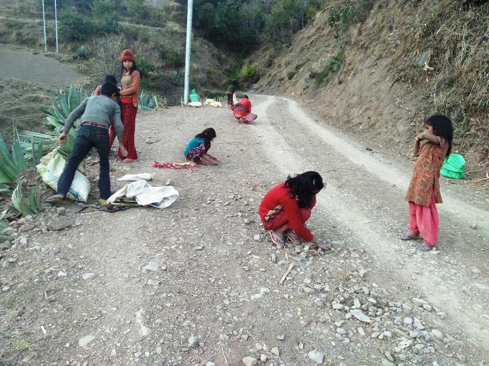 Students crushing stones to manage educational expenses