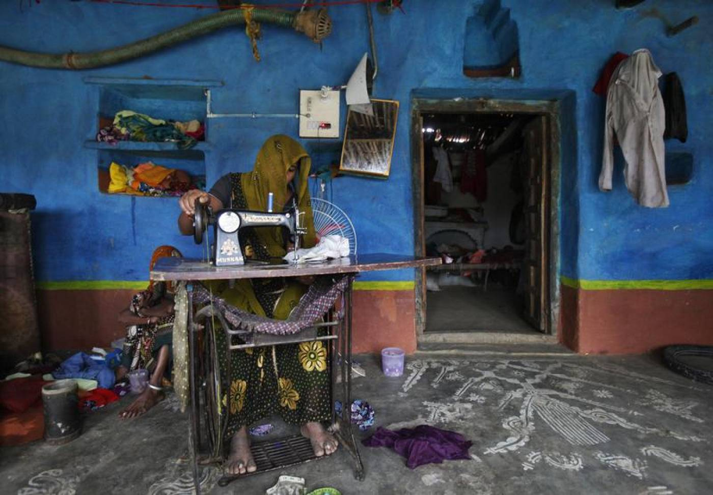 India's 'invisible' home garment workers exploited by fashion brands