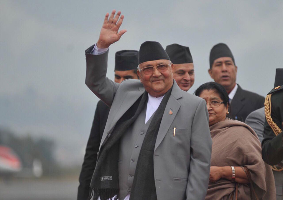 PM Oli returns home (with photos)