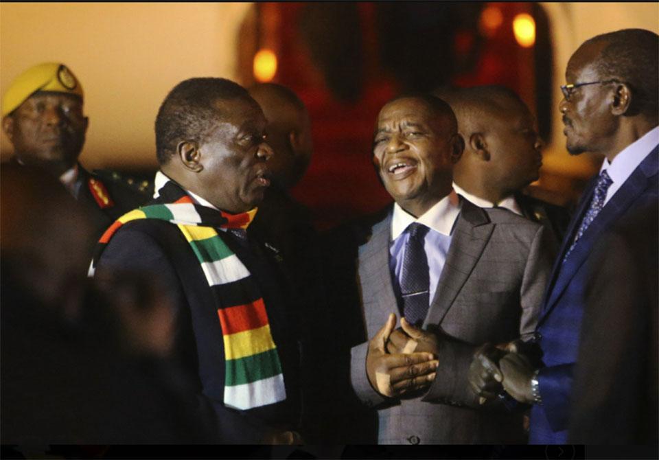 Zimbabwe's president returns amid economic crisis, crackdown