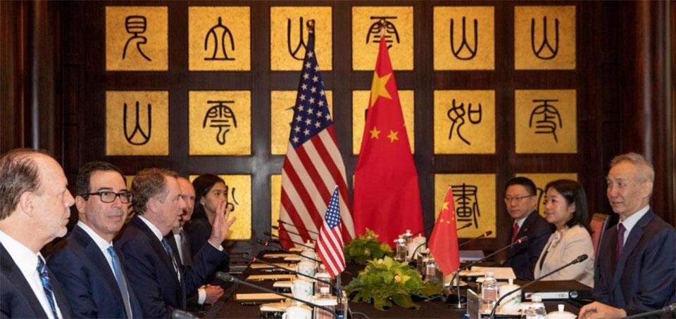 U.S., China meet for trade talks as Trump talks tough