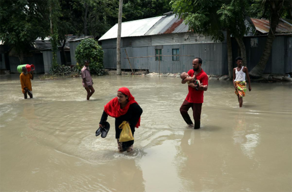 More than 60 killed, hundreds of thousands displaced by flooding in Bangladesh