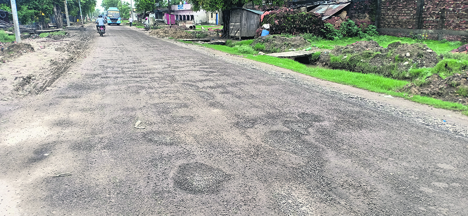 Blacktopped road damaged within a month of construction
