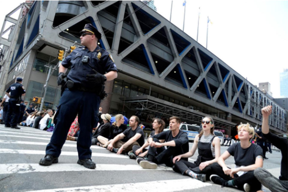 Police arrest 70 climate change protesters outside New York Times