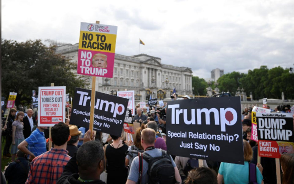 Donald Trump turns to Brexit and Huawei as protesters mock with a 'blimp'