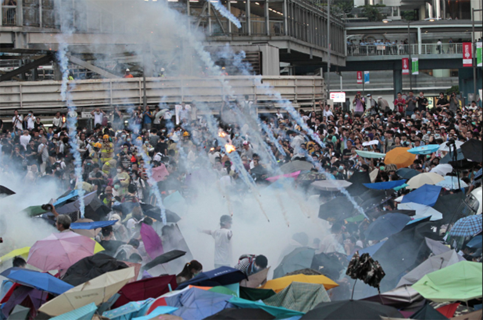 Protesters scuffle with Hong Kong police, government offices shut