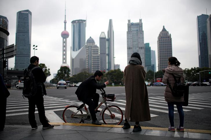 Asia firms spend less and save more as China economy slows