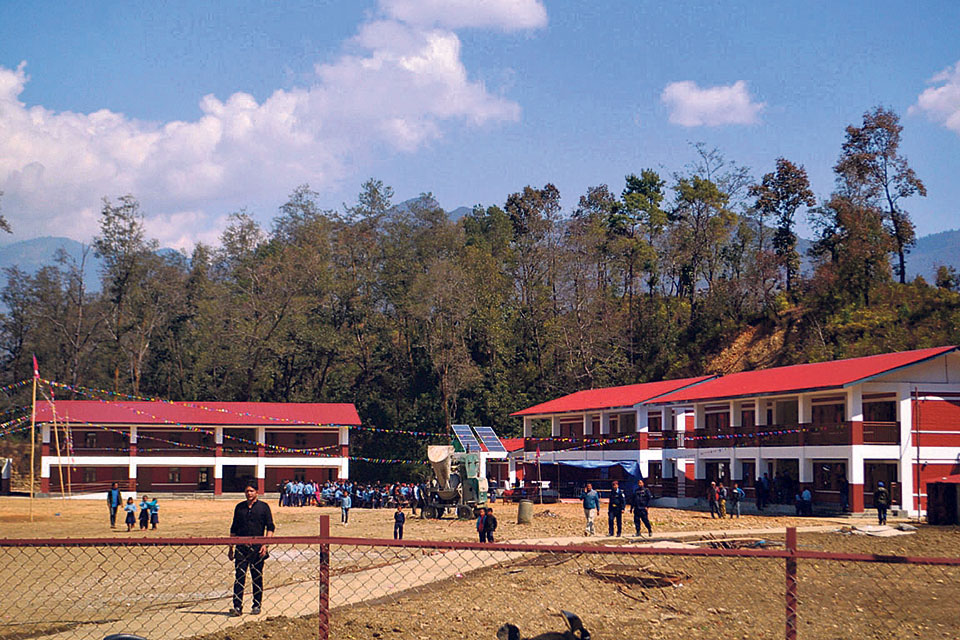 Quake-hit remote school gets posh new buildings
