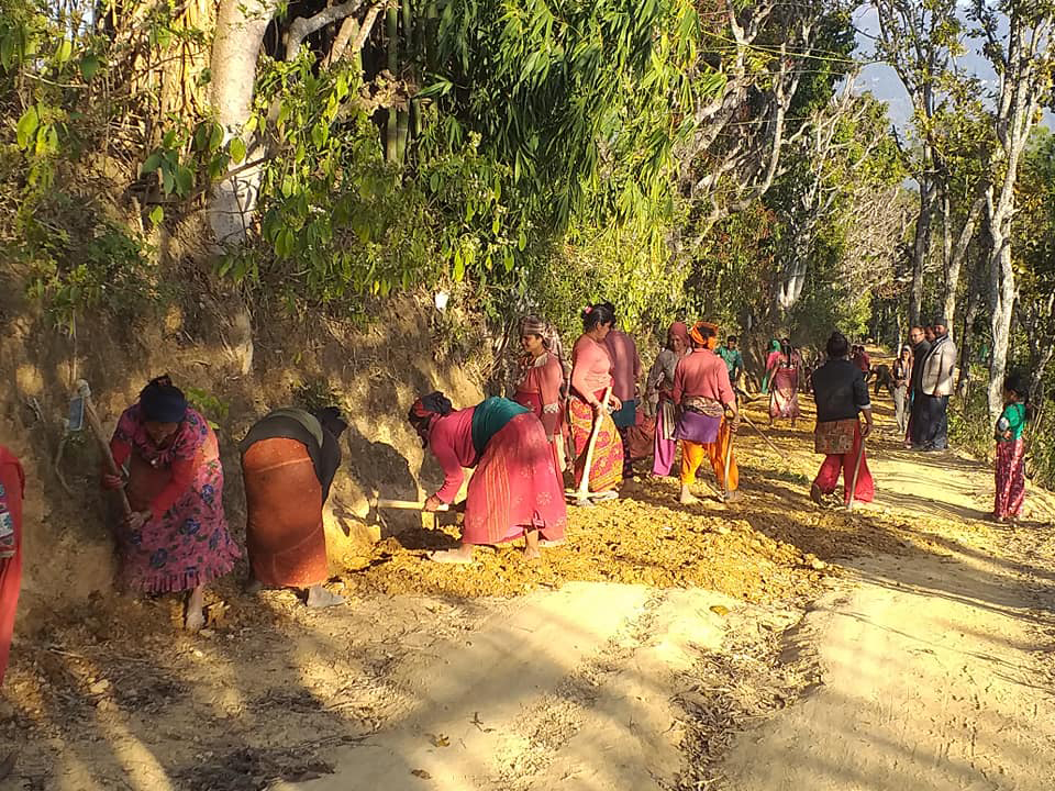Locals work together to build road on their own