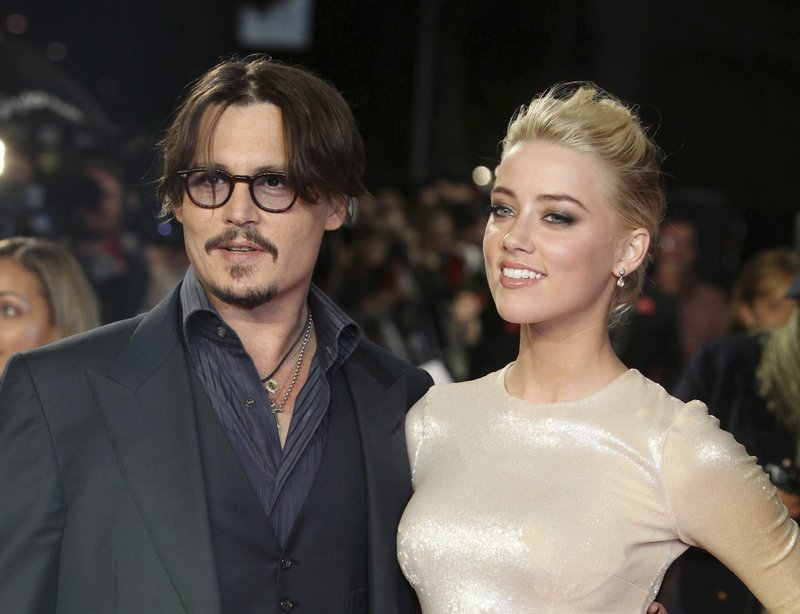 Johnny Depp's ex-wife asks judge to dismiss his lawsuit