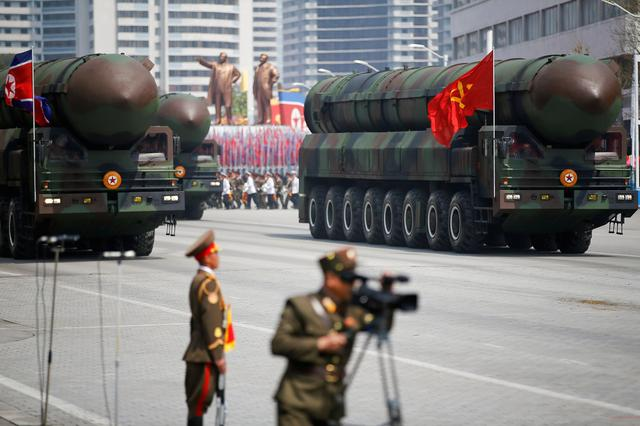 North Korea rebuilds part of missile site as Bolton warns of more sanctions