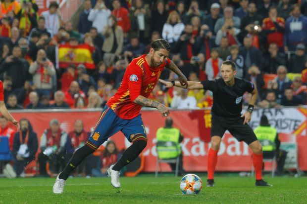 Nerveless Ramos gives Spain winning start