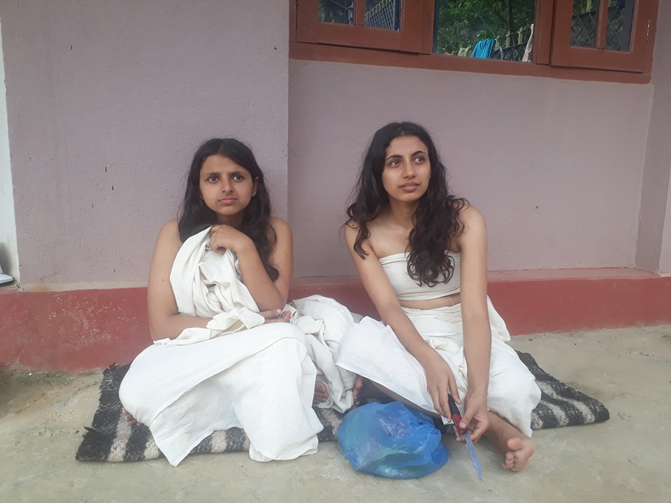 Daughters perform final rites of their mother