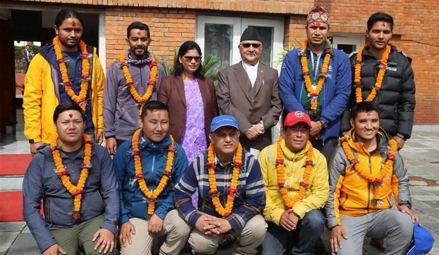 Survey officials successfully scale Mt. Everest