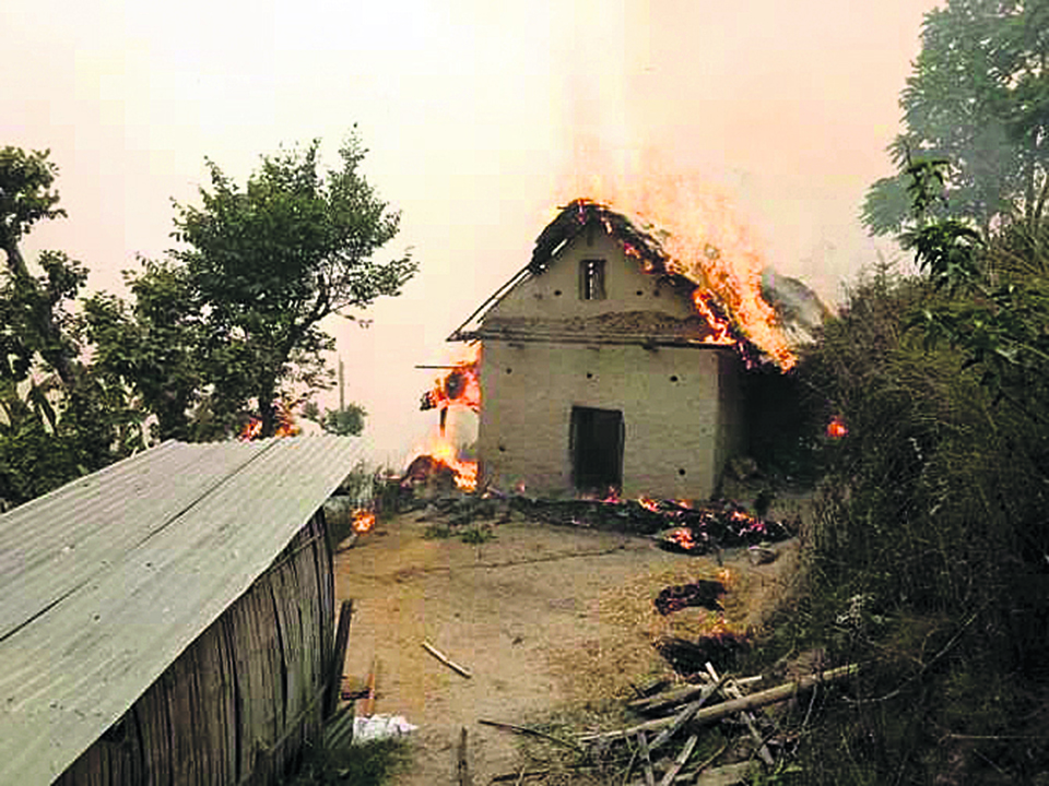 Wildfire kills two, 13 houses damaged