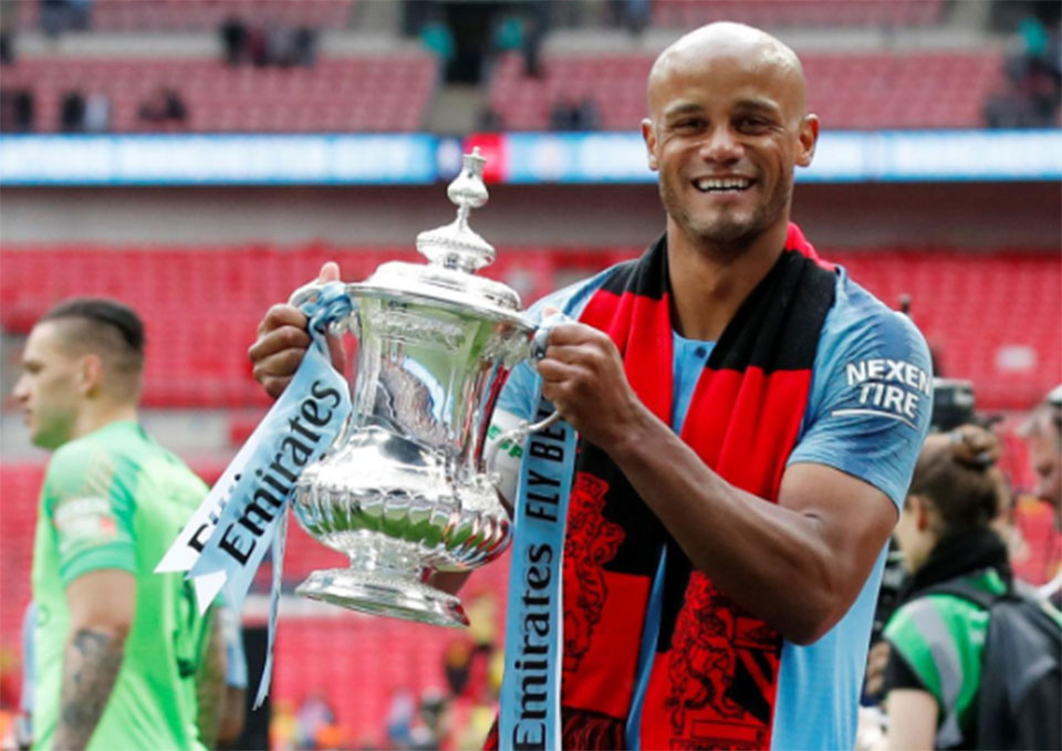 Kompany to leave Man City on a high after treble